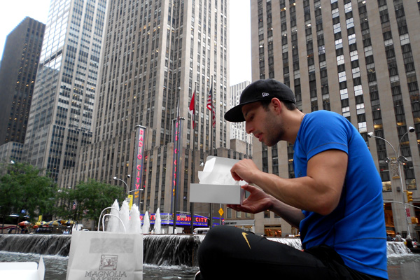 Alec of Still Served Warm eating Magnolia Cupcakes in midtown Manhattan