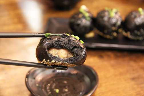 Black sheng jian bao, made with bamboo charcoal, in Shanghai