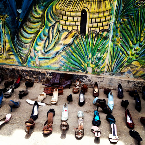 A painted mural and shoes in Dakar, Senegal.