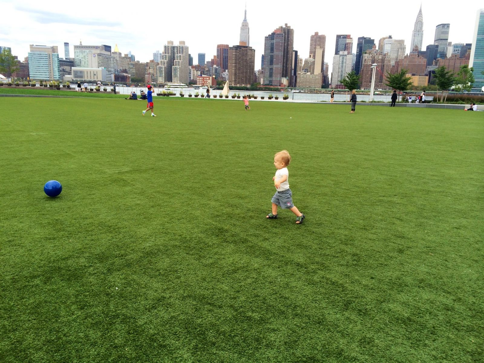 Child playing in front of NYC skyline