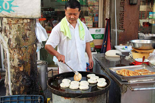Green onion, or scallion, pancakes, on the street in Shanghai