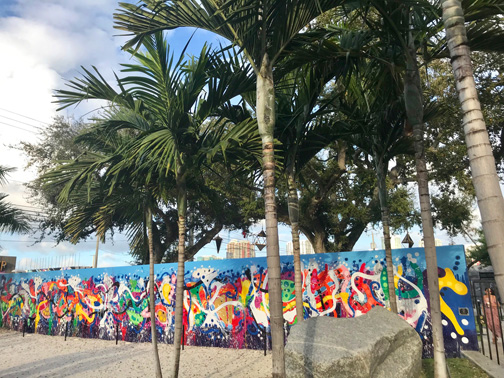 Palm trees in front of an outdoor mural in the Wynwood Walls, Miami, FL.