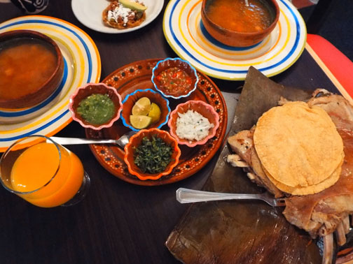 Barbacoa with consome, sopes, and salsas in Mexico City