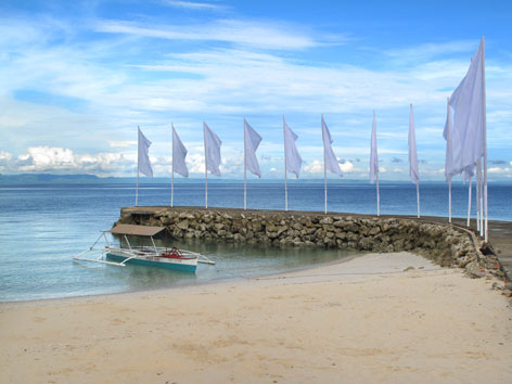 Flags on a beach in Cebu, the Philippines