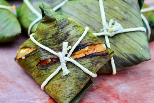 Antiguan ducana, a sweet potato dumpling, wrapped in a banana leaf and twine