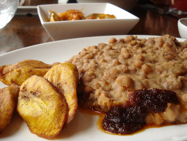 Ewa agoyin, a bean dish with spicy sauce, is an iconic Nigerian food.