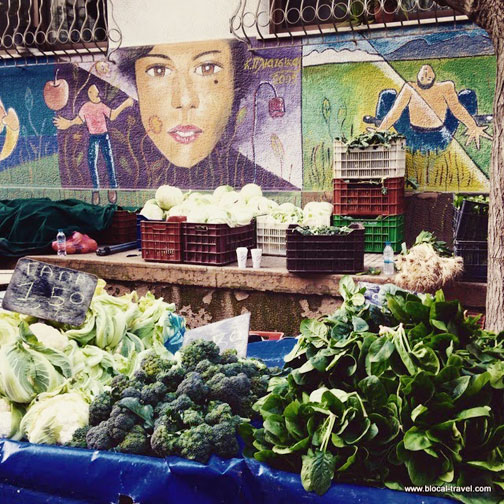 Farmers market stand with murals at Exarchia in Athens, Greece
