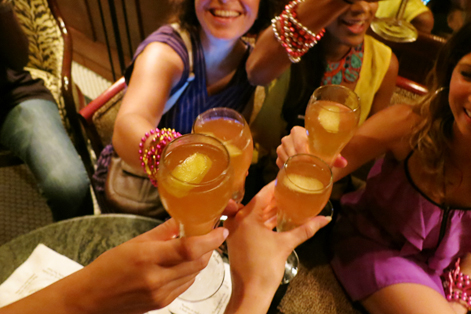 Girls drinking French 75s in New Orleans