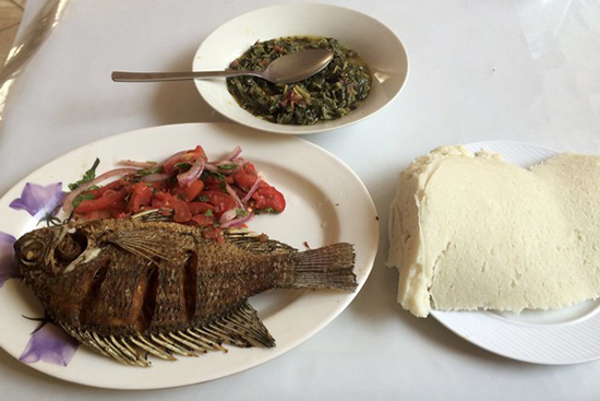 Fried tilapia and ugali, traditional foods in Kenya.