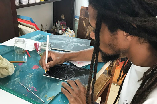 An artist works in a studio in Havana, Cuba, open for art classes to tourists.