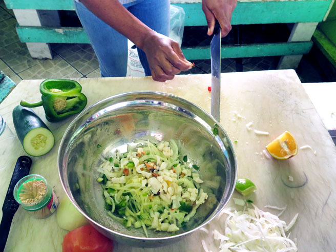 Vendor making conch salad in the Bahamas