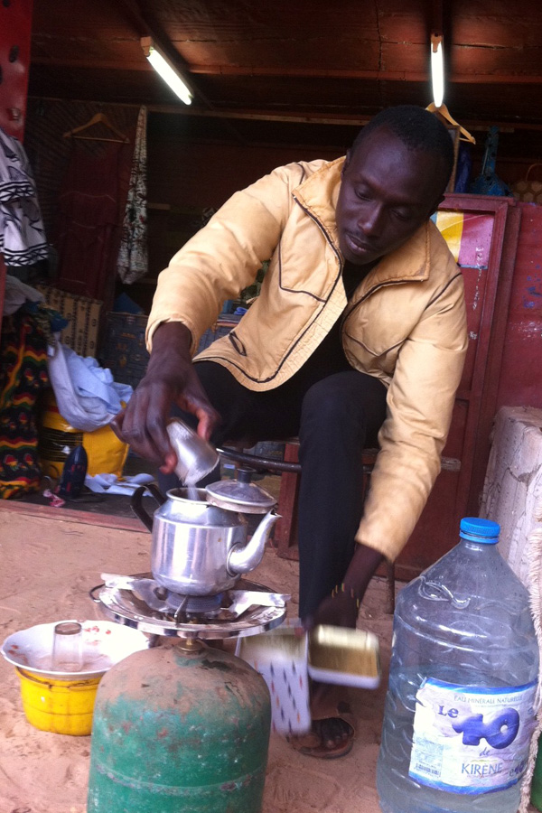 Senegalese man makes green tea in Popenguine, Senegal
