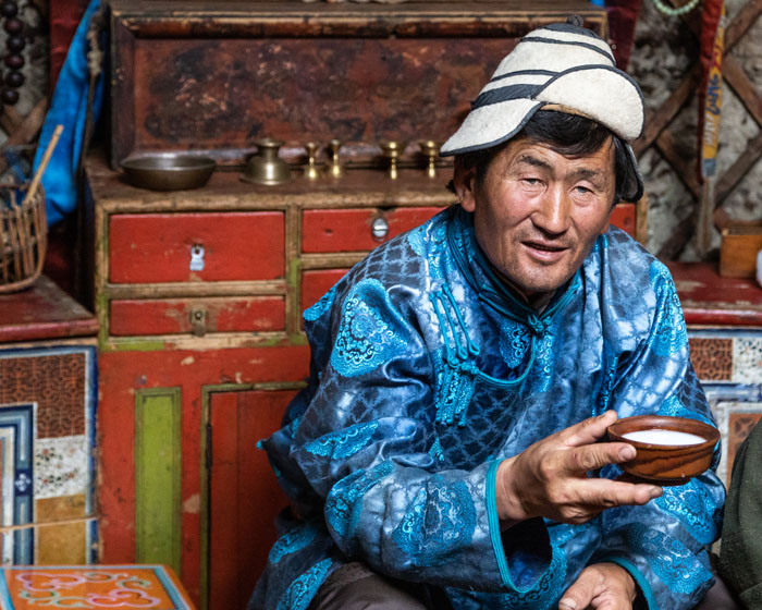 A Mongolia man holds a cup of airag, a traditional liquor, in Mongolia.