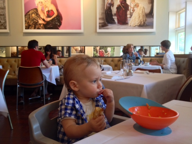 Baby eating in a restaurant