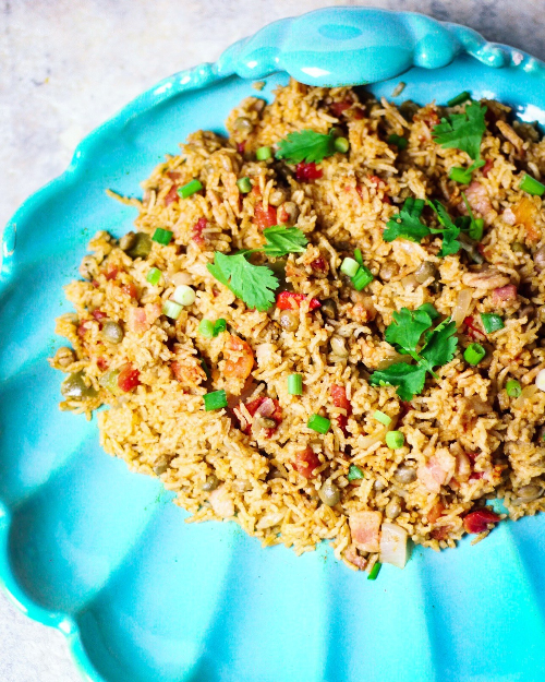 Bahamian peas and rice on a turquoise platter, with a recipe.