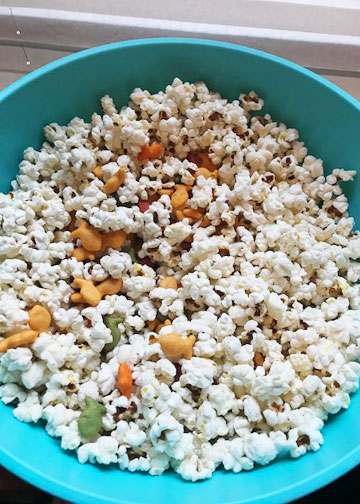 Popcorn mixed with Goldfish crackers for a movie night.