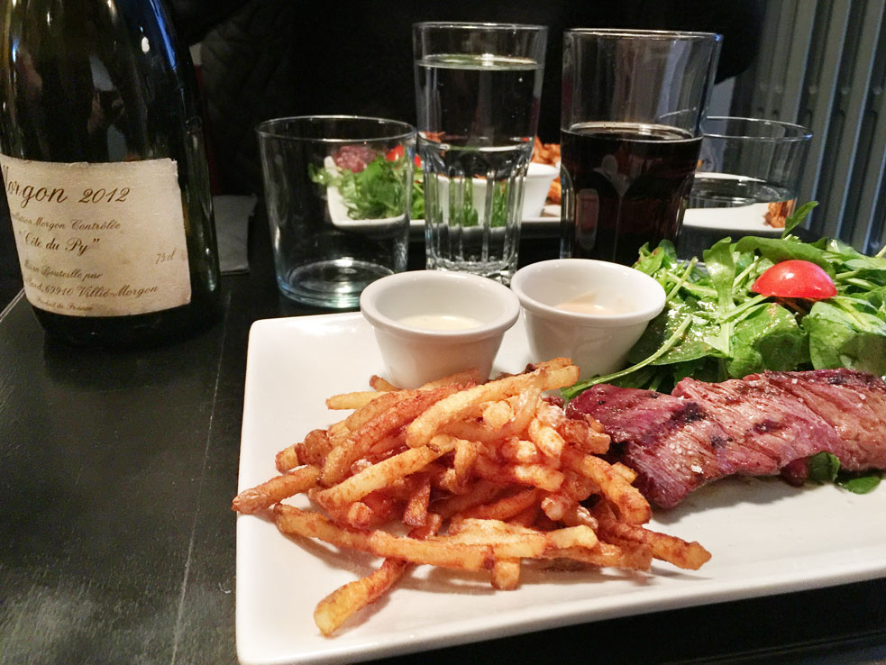 Steak frites for lunch, at a Parisian bistro