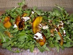 Argula salad with local peaches, tomatoes, and goat cheese from Rezaz in Asheville, North Carolina.