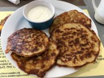 Acadian potato pancakes with sour cream in Nova Scotia.