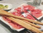 A plate of prosciutto di Parma with breadsticks in Modena, Emilia-Romagna, Italy